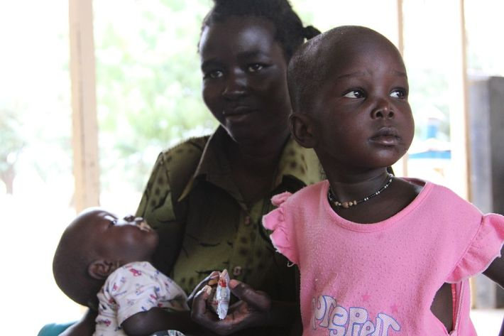 1024px-Tackling_malnutrition_in_Kenya_with_UNICEF_and_plumpy_nut_(6219652473)